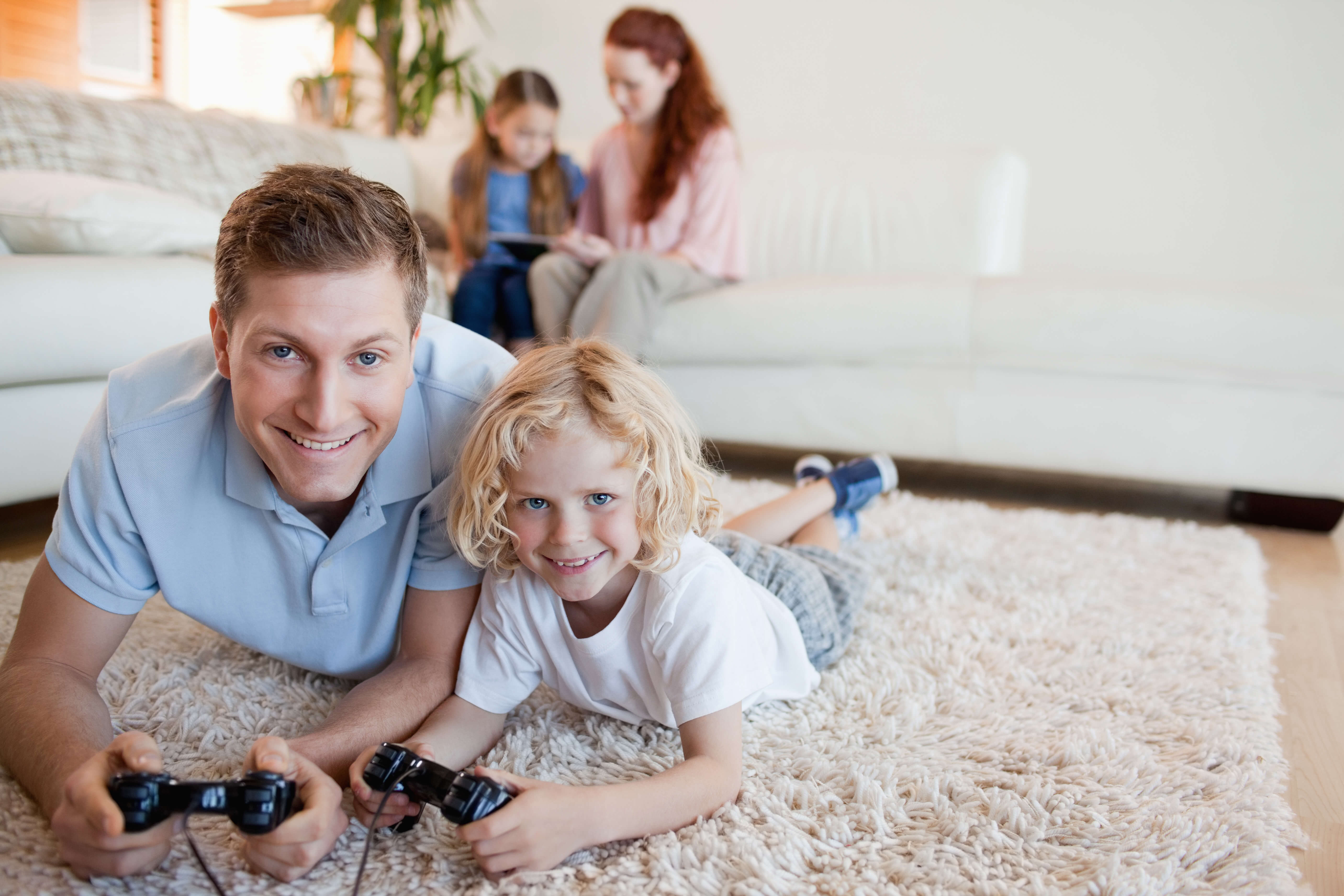family playing on clean carpet